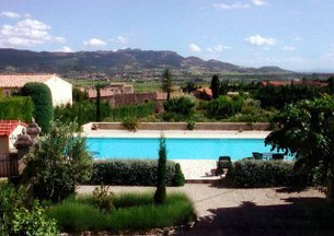 View from House over swimming pool, garden and Dentelles des Montmirail
